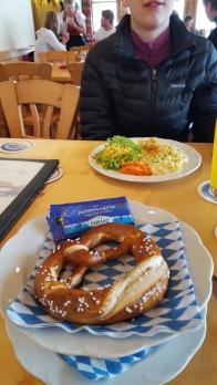 Bavarian pretzel and Josie is eating her favorite Käsespätzle